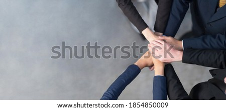 Top view, Cropped view of A group of Business people putting their hands together, Friends with stack of hands showing unity, Teamwork, Success and Unity concept