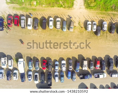 Top view crowded parking lot along shoreline of Galveston beach, Texas, America