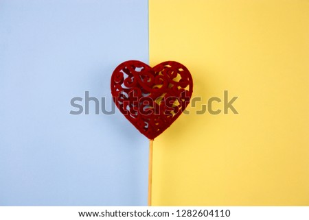 top view cute red  heart on a blue and yellow background #1282604110