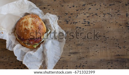 Top view delicious hamburger on wooden background. Fast food meal  #671332399
