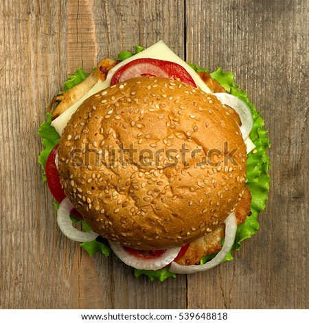 Top view delicious hamburger on wooden background. Fastfood meal #539648818