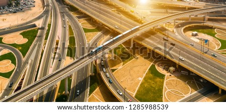 Top view Dubai Metro Network line on the urban landscape UAE, architecture with subway monorail train automated.