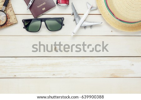 Top view essential travel items. map, passport, airplane, eyeglasses on modern rustic white wooden background.Free space for creative design text and word.Flat lay different object for mock up.