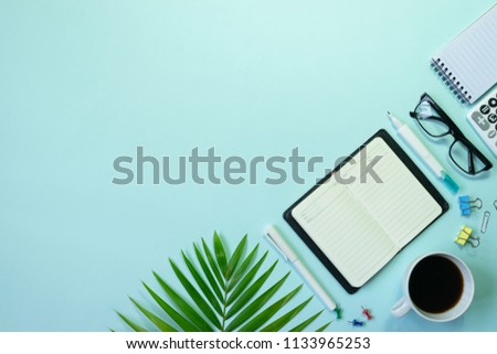 Top view,flat lay,notebook,pen,paperclip or object for office apply concept on blue background.