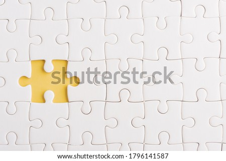 Top view flat lay of paper plain white jigsaw puzzle game texture incomplete or missing piece, studio shot on a yellow background, quiz calculation concept Сток-фото ©