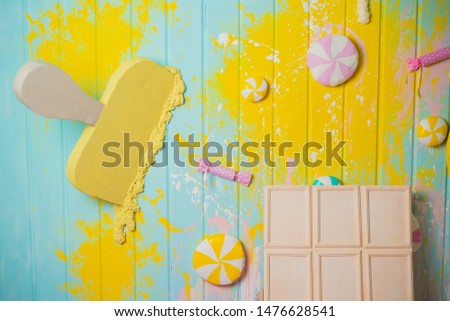 Top view, Flatlay template design of a bar of white chocolate and ice cream on wooden background with copy space. Top view, Flatlay template design a group of sweets #1476628541