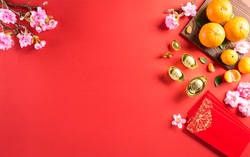 Top view for Happy Chinese new year or Lunar new year festival decorations on a red background. ( Chinese characters
