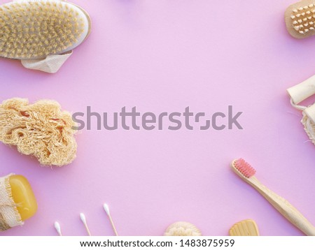 Top view frame with wooden items on pink background