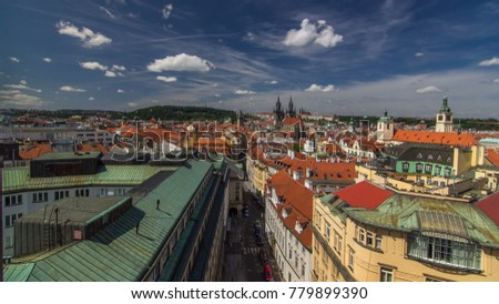 Top view from the height Powder Tower in Prague timelapse to Old Town. Historical and cultural monument. The place is particularly popular among tourists. Prague, Czech Republic. #779899390