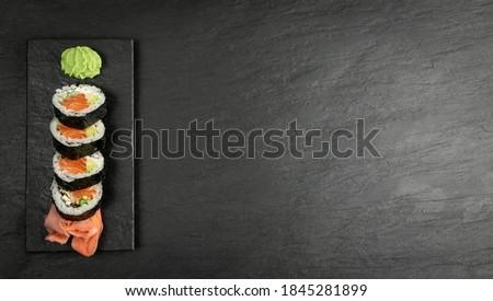 Top View Futomaki Philadelphia Sushi Rolls Mockup. Salmon Hosomaki Sushi, Maki Sushi Rolls with Raw Trout, Avocado, Cucumber, Philadelphia Cheese with Copy Space