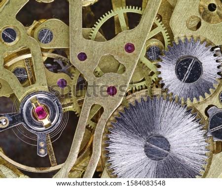 top view gears of a golden mechanical pocket watch, mechanism of a clock