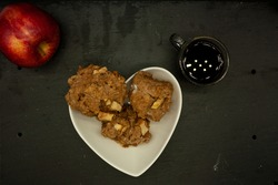 top view Healthy and nutritious breakfast of natural fruit apple coffee and oatmeal cookies with apple on stone slate in Mexico