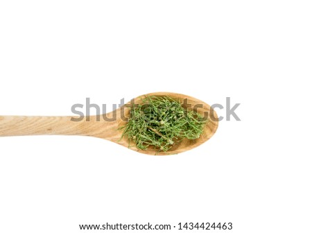 Top view heap of dried natural herbal remedy called Equisetum arvense the field horsetail or common horsetail on wooden spoon isolated on white background. #1434424463