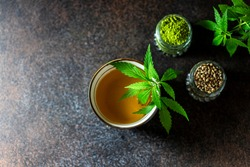 Top view Hemp Tea. Cannabis herbal tea. Selective focus, copy space.