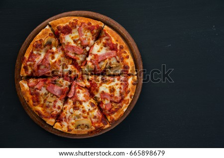 Top view homemade pizza with copy space on black background
