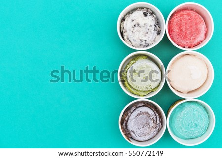 Shutterstock Top view Ice cream flavors in cup on green background