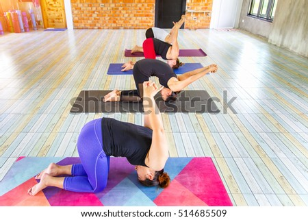 Top View Image Fitness Asian Female Group Doing Namaste Yoga Pose In Row At The