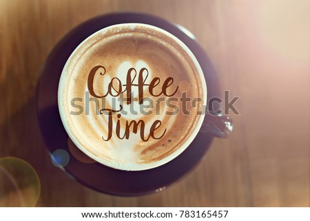 Top view image of coffee cup on wooden desk with text. Coffee Time. Flat lay.