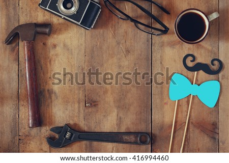 top view image of fathers day composition with vintage father\'s accessories on wooden table. vintage filtered