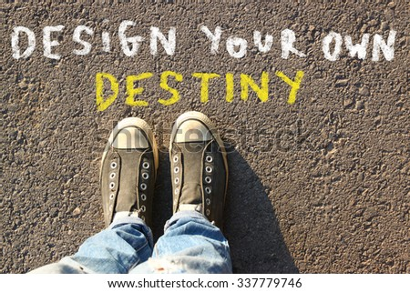 Photo of top view image of person in jeans and sneakers with the text - design your own destiny