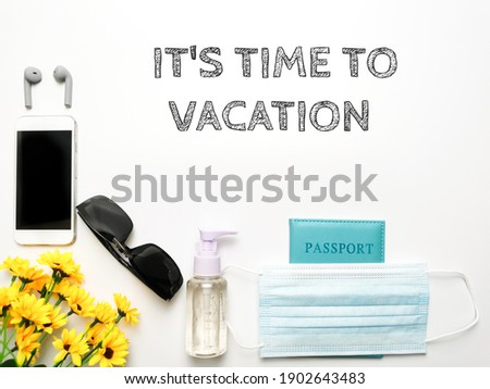 Top view image with text IT'S TIME TO VACATION, with handphone, flower, sunglasses, sanatize spray, face mask and passport. Isolated with white background. vacation concept  Stok fotoğraf ©