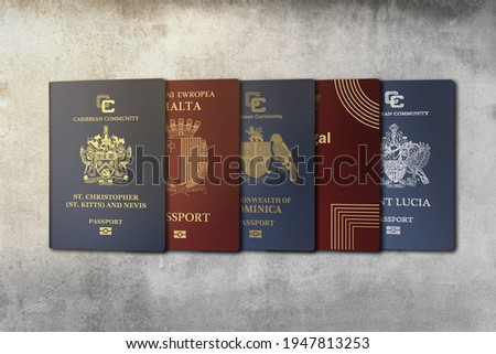 Top View, International Passports, citizenship  by Investment, Nationality, Malta, Citizens of Kitts and Nevis, Portugal, Dominica, Saint Lucia On a concrete wall  Stockfoto ©