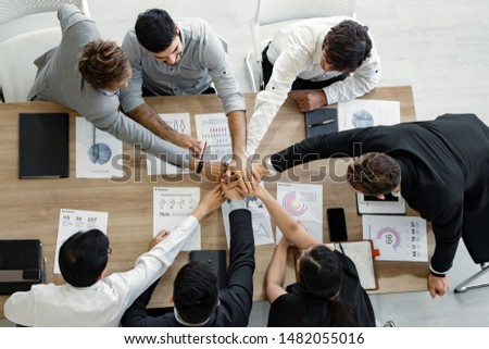 Top view join hands on work table of team of Asian people and foreigners at meeting. Hands coming together of teamwork. Concept of teamwork. #1482055016