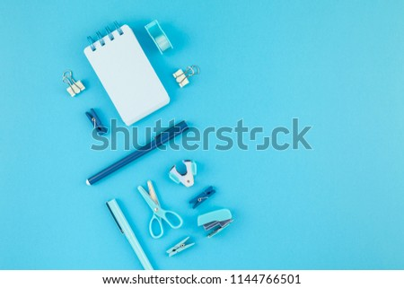 Top view knolling flat lay of workspace desk styled design school and office supplies with copy space turquoise blue color paper background minimal style. Template for feminine blog social media - Shutterstock ID 1144766501