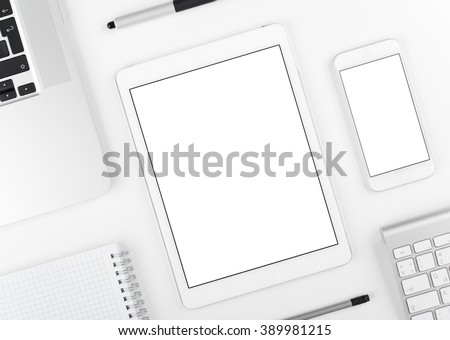 Top view: Laptop tablet and smartphone alike on ipad and iphone on white table background with text space and copy space. #389981215