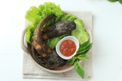 Top View Lele Goreng or Fried Catfish is Traditional Indonesian Culinary Food. Catfish and Chilli Tomato Paste, Popular Street Food Called Pecel Lele Lamongan