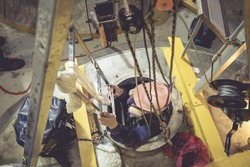 Top view male climb up the stairs into the tank stainless chemical area confined space safety blower fresh air