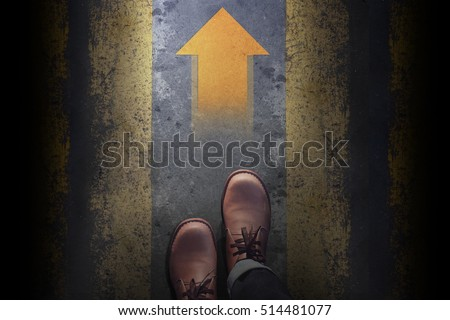 Top view, Male with Leather Shoes, Steps and follow an Arrow light on Grunge Dirty Concrete Floor Background, Way to Success for Leadership, Follow the leader Concept