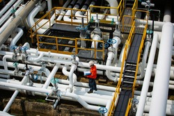 Top view male worker inspection at valve of visual check record pipeline oil and gas industry