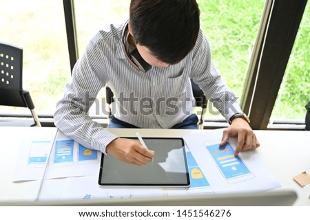 Top view Man working with layout paper and digital tablet, UX UI designer. #1451546276