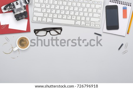 Top view messy home office desk setting - Shutterstock ID 726796918