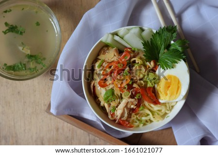 top view mie ayam rica-rica is noodles with rica-rica chicken topping, which is coarse chopped chicken with spicy seasoning