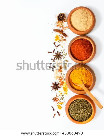 Top view mix indian spices and herbs difference terracotta pots on white background with copy space for design vegetable, healthy lifestyle, spices, herbs or foods content