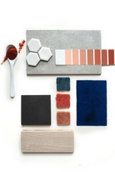 Top view moodboard. Material samples. Blue, red, orange, black, light wood.A spoonful of red color