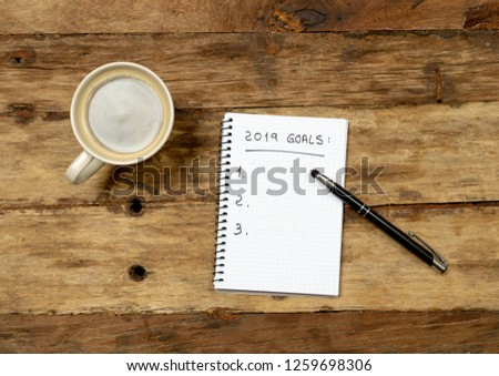 Top View 2019 New year resolutions list with wishes for new happy lifestyle on notepad coffee on Vintage table background in Wish list Plans and Goals for happiness Aspiration and Motivation Concept.
