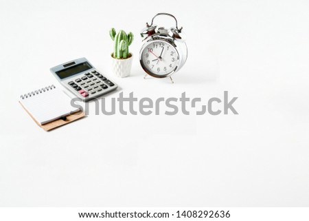Top view objects clock, small cearamic cactus green ,calculation and small notebook on white background isolated, idea home loan background or home finance concept. sensitive focus.