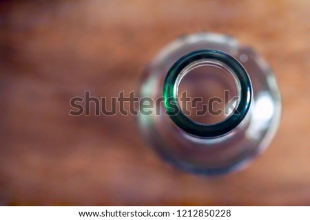 Top View Of A Bottleneck, Empty Bottle On A Wooden Table. Healthy Living And Detox Concept. Abstinence, Alcoholism Treatment. New Year's Resolutions. Becoming A New You, Promising A Better Life.