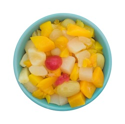 Top view of a bowl of canned fruit cocktail in a bowl isolated on a white background.