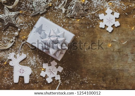 2f0350b941cf Top view of a Christmas present wrapped in silver and white paper with stars  with white