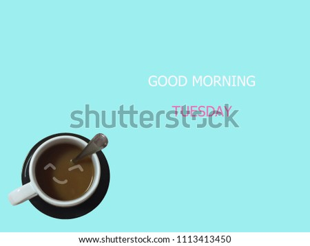 top view of a cup of coffee with good morning tuesday is on blue background. tuesday concept #1113413450