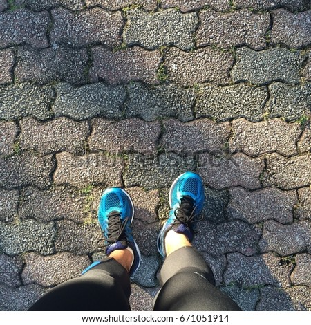 Stock Photo Top view of a foot with Asics Cumulus running shoe.