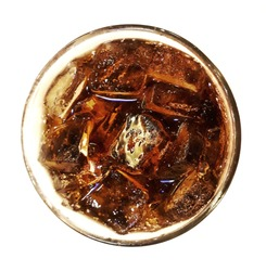 Top view of a glass of cola on white background, selective focus.