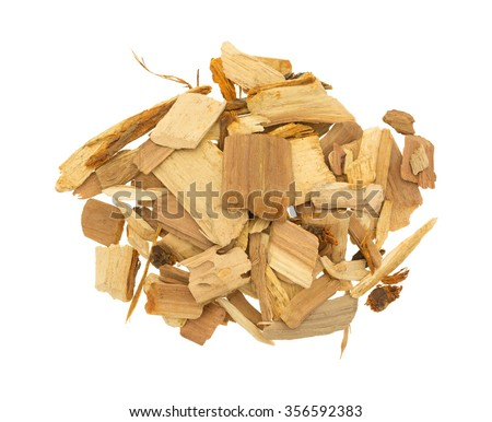 Top view of a group of apple wood chips for flavoring barbecue and grilled foods isolated on a white background.