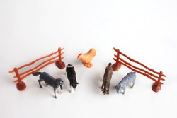 Top view of a  group of farm plastic animals toys for kids isolated on white background