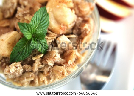 Top view of a home made apple crumble with fork