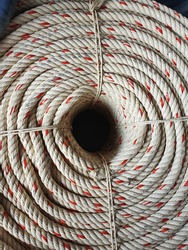 Top view of a large manila rope woven into a valley or polypropylene rope wrapped in a red circle inside. Combined for convenient and neat use. Often used to hitch boats or lift heavy objects.